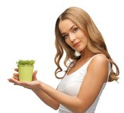 Woman with green grass in pot Royalty Free Stock Photography