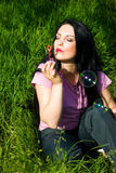 Woman in green grass with soap bubbles stock photo