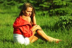 Woman on green grass Stock Image