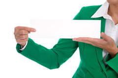 Woman in green holding empty with billboard or sign in her hands Royalty Free Stock Photo