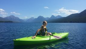 Woman on Green Kayak on Body of Water during Daytime Royalty Free Stock Photography