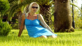 The woman on the green lawn Royalty Free Stock Image