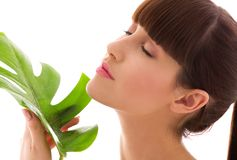 Woman with green leaf Stock Photos
