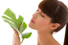 Woman with green leaf Stock Images