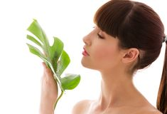 Woman with green leaf Royalty Free Stock Images