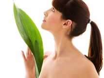 Woman with green leaf. Picture of woman with green leaf over white royalty free stock images