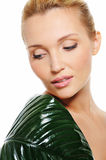 Woman with green leaf cover her shoulder Stock Image