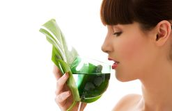 Woman with green leaf and glass of water Stock Photos