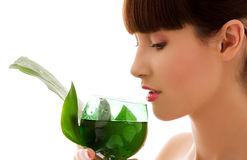 Woman with green leaf and glass of water Royalty Free Stock Photography