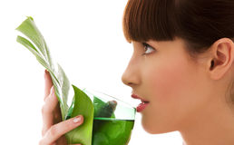 Woman with green leaf and glass of water Stock Photo