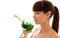 Woman with green leaf and glass of water Royalty Free Stock Photos