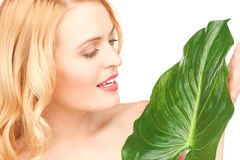 Woman with green leaf over white Stock Images