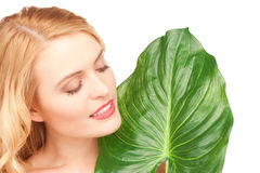 Woman with green leaf over white Royalty Free Stock Photography