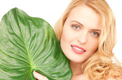 Woman with green leaf over white Stock Photo