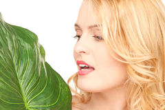 Woman with green leaf over white Royalty Free Stock Photos