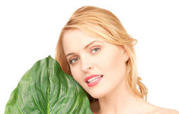 Woman with green leaf over white Royalty Free Stock Image