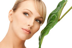 Woman with green leaf Stock Photo