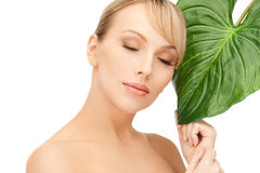 Woman with green leaf Royalty Free Stock Photos