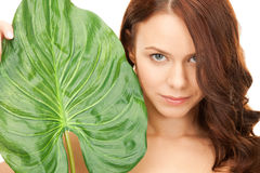 Woman with green leaf Stock Photography