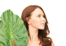 Woman with green leaf Royalty Free Stock Photography