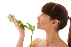 Woman with green leaf Royalty Free Stock Image