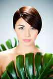 Woman and green leaves Royalty Free Stock Photos