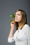 Woman with green leaves Stock Images