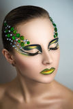 Woman with green make up stock images