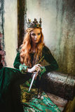 Woman in green medieval dress Stock Image