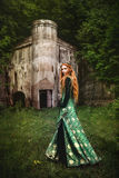 Woman in green medieval dress stock photo