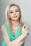 Woman in green with microphone Royalty Free Stock Photo