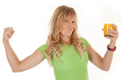 Woman green muscles orange juice Royalty Free Stock Photos