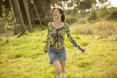 Woman in green outdoor running. And smiling happy Stock Photography