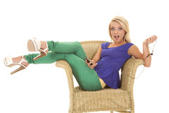 Woman green pants headphones open mouth Royalty Free Stock Image