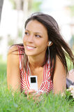 Woman in green park, music and relax. Young woman listening music with headphones  in green park Stock Image