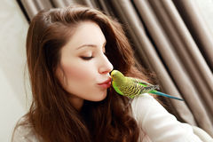 Woman with green parrot Stock Photos