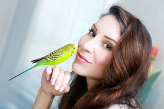 Woman with green parrot Stock Images