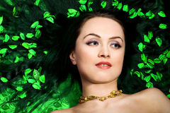 Woman in green petals Royalty Free Stock Photo