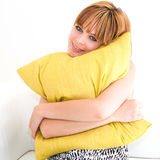 Woman with green pillow Royalty Free Stock Images
