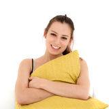 Woman with green pillow Stock Photos