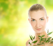 Woman with green plant Stock Image