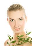 Woman with green plant. Beautiful young woman with green plant close-up portrait stock photo