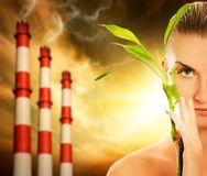 Woman with green plant. Young woman with green plant. Global warming concept Stock Photo