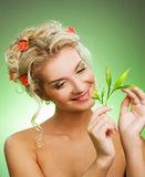 Woman with green plant. Young woman with green plant. Isolated on whte Stock Photo