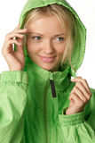 Woman in green raincoat. Portrait of young woman wearing green mackintosh Royalty Free Stock Images