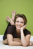 Woman in green room Royalty Free Stock Photography