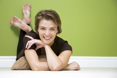 Woman in green room Stock Image