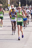 Woman in Green Running the Comrades Marathon Stock Photos