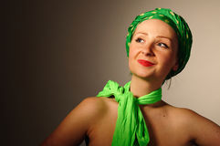 Woman in green scarf. Stock Image
