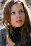 Woman in green scarf. Portrait of young brunette woman in green scarf Stock Photos